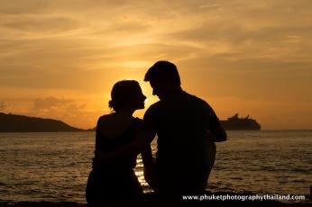 couple at kalim beach , phuket , thailand